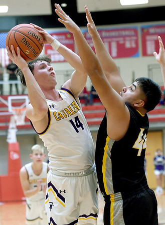 Thomas Jefferson's Dylan Dean-Heck (14) drives to the basket as Purdy's Osiel Aldava (44)) defends during their Class 2 District 12 championship game on Friday night at Webb City High School.<br /> Globe | Laurie Sisk