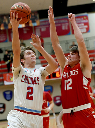 Webb City's Tanner Rogers (2) scores over Carl Junction's Jackson Huffman (12) during their game on Tuesday night at WCHS.<br /> Gklobe | Laurie Sisk