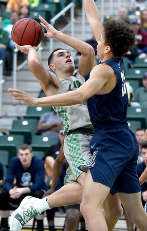 Missouri Southern's Kinzer Lambert drives to the basket as Lincoln's DaMani Jarrett defends during their game on Saturday at Leggett & Platt.<br /> Globe | Laurie Sisk