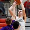 College Heights' Miller Long (24)  shoots over Verona's Riley Carey (11) during their Class 2 District 12 opener on Saturday at Webb City High School.<br /> Globe | Laurie SIsk