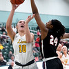 Missouri Southern's Zoe Campbell (10) tries to score over Central Missouri's Nija Collier (24) during their game on Wednesday night at Leggett & Platt.<br /> Globe | Laurie SIsk