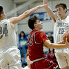 Joplin JV's Carson Wampler (23) drives between College Heights defenders Miller Long (24) and Hagen Beck (20) during the championship game at the McAuley Warrior Classic on Saturday at McAuley.<br /> Globe | Laurie Sisk