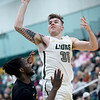 Missouri Southern's Cam Martin (31)shoots over Missouri Western's Tony Chukwuemeke (42) during their game on Saturday at Leggett & Platt.<br /> Globe | Laurie Sisk