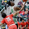 Missouri Southern's Elyjah Clark (15) drives to the basket and draws a foul on Central Missouri's Walter Sorrels, Jr. (20) during their game on Wednesday night at Leggett & Platt.<br /> Globe | Laurie SIsk