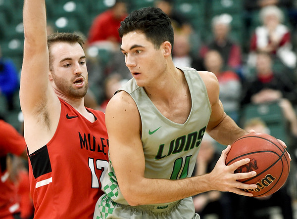 Missouri Southern'sKinzer Lambert (11) looks to get past Central Missouri's Michael Winger (12) during their game on Wednesday night at Leggett & Platt.<br /> Globe | Laurie SIsk
