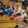 Mt. Vernon's Lacy Stokes battles with Nevada's Alison Bower for a loose ball during Monday's game in Mt. Vernon.<br /> Globe | Roger Nomer