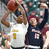 Missouri Southern's Chasidee Owens (2) outs up a shot as Rogers State's Alicia Brown (10) defends during their game on Saturday at Leggett & Platt.<br /> Globe | Laurie Sisk