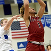 Joplin's Zach Westmoreland (1) drives past Carthage's Patrick Carlton during their game on Tuesday night at CHS.<br /> Globe | Laurie Sisk