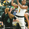 Missouri Southern's Destiny Cozart (1) dishes off to a teammate as Northwest's Kylie Coleman (4) defends during their game on Thursday night at Leggett & Platt.<br /> Globe | Laurie SIsk