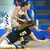 McAuley's Kayleigh Teeter, left, battle Providence's Kenna McCurdy (5) for a loose ball during their game in the Warrior Classic on Friday night at McAuley.<br /> Globe | Laurie Sisk