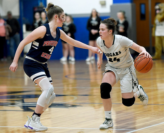 College Heights' Emmy Colin (24) looks to get past Providence's Hannah Weidman (4) during the championship game at the McAuley Warrior Classic on Saturday at McAuley.<br /> Globe | Laurie Sisk