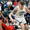 Rogers State's Gabriel Ferreira (23) takes a charge from Missouri Southern's Cam Martin (31) during their game on Saturday at Leggett & Platt.<br /> Globe | Laurie Sisk