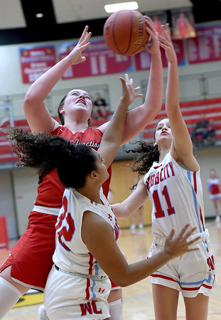CArl Junction's Katie Scott battles Webb City's Kajah Jackson (32) and Raven Vaughn (11) for a rebound during their game on Tuesday night at WCHS.<br /> Globe | Laurie Sisk