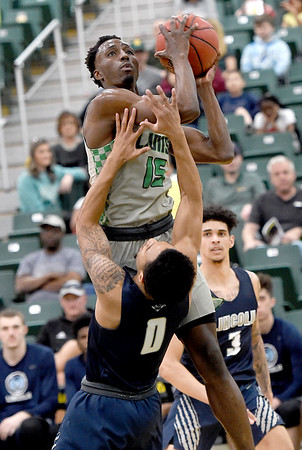 Missouri Southern's Elyjah Clark (15) drives to the basket as Cameron Potts (0) defends during their game on Saturday at Leggett & Platt.<br /> Globe | Laurie Sisk