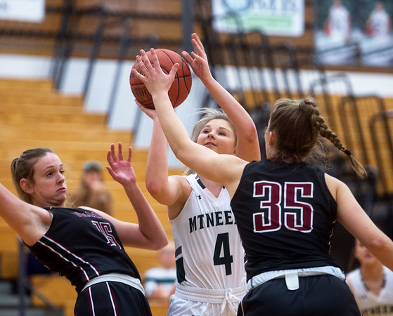 Mt. Vernon's Cameryn Cassity puts up a shot between Nevada's Lindley Ferry (15) and Alison Bower (35) during Monday's game in Mt. Vernon.<br /> Globe | Roger Nomer