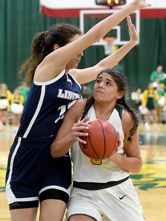 Missouri Southern's Layne Skiles drives to the basket as Lincoln's Anna Munoz Vidueira defends during their game on Saturday at Leggett & Platt.<br /> Globe | Laurie Sisk