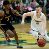Missouri Southern's Parker Jennings, right, fights to get past Missouri Western's Tyrell Carroll during their game on Saturday at Leggett & Platt.<br /> Globe | Laurie Sisk