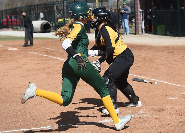 Missouri Southern's Tori Frazier crosses home plate as Missouri Western catcher  Chloe Armstrong awaits the throw during their game in the 15th Annual Teri Mathis Zenner Memorial Classic on Friday afternoon at Pat Lipira Field.<br /> Globe | Laurie Sisk