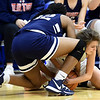 McAuley's Abi Street, right, battle Providence's Michell Butler (32) for a loose ball during their game in the Warrior Classic on Friday night at McAuley.<br /> Globe | Laurie Sisk