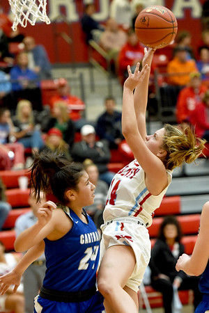 Webb City's Jaydee Duda (14) drives to the basket as Carthage's Kianna Yates (24) defends during their game on Tuesday night at the Cardinal Dome.<br /> Globe | Laurie Sisk