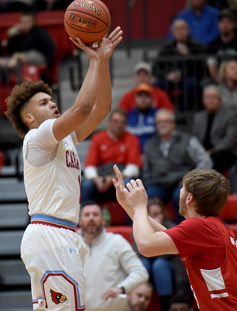 Webb City's Terrell Kabala, left, puts up a shot as Carl Junction's Alex Dixon defends during their game on Tuesday night at WCHS.<br /> Gklobe   Laurie Sisk