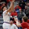 Webb City's Terrell Kabala, left, puts up a shot as Carl Junction's Alex Dixon defends during their game on Tuesday night at WCHS.<br /> Gklobe | Laurie Sisk