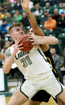 Missouri Southern's Cam Martin (31) fights for position as Missouri Western's Alex John defends during their game on Saturday at Leggett & Platt.<br /> Globe | Laurie Sisk