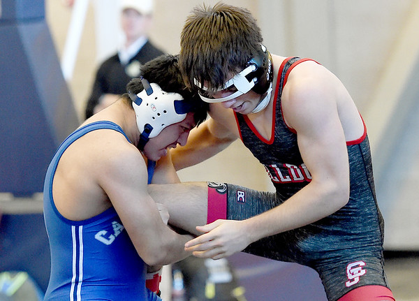 Carthage's Anderson Ixcol, left, works to take down Carl Junction's Ethan Walker during their 145 lb. match on Saturday at JHS.<br /> Globe | Laurie Sisk