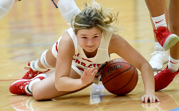 Webb City's Darcy Darnell dives for a loose ball during the Cardinals game against Carthage on Tuesday night at the Cardinal Dome.<br /> Globe | Laurie Sisk