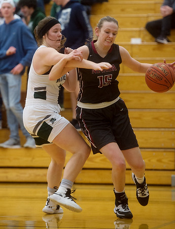 Nevada's Lindley Ferry drives against Mt. Vernon's Allie Schubert during Monday's game in Mt. Vernon.<br /> Globe | Roger Nomer