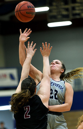 Ozark Christian's Jessica Watson (22) shoots over Central Chrstian's Elizabeth Willouer (2) during their first round game of the Midwest Christian College Conference tournament on Thursday night at OCC.<br /> Globe | Laurie Sisk