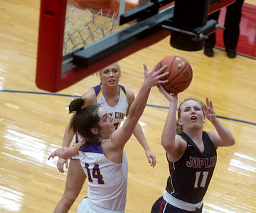 Monett's Kelsey Dalton blocks a shot by Joplin's Brooke Nice during Monday's game in Seneca. Globe | Roger Nomer