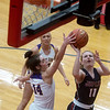 Monett's Kelsey Dalton blocks a shot by Joplin's Brooke Nice during Monday's game in Seneca.<br /> Globe | Roger Nomer