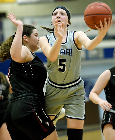 Ozark Christian's Annie Jaycox (5) shoots as Central Chrstian's Elizabeth Willouer (2) defends during their first round game of the Midwest Christian College Conference tournament on Thursday night at OCC.<br /> Globe | Laurie Sisk