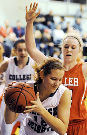 Globe/T. Rob Brown<br /> College Heights Christian School's Allison Strawn brings down a rebound against Miller's Emily Allen Monday evening, Jan. 30, 2012, during McAuley Catholic High School's Warrior/Lady Warrior Classic in McAuley's gymnasium.