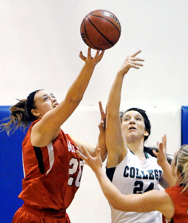 Globe/T. Rob Brown<br /> College Heights Christian School's Mackenzie Paden and Miller's Jessica McAdams compete for a rebound Monday evening, Jan. 30, 2012, during McAuley Catholic High School's Warrior/Lady Warrior Classic in McAuley's gymnasium.