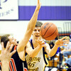 Globe/T. Rob Brown<br /> Thomas Jefferson's Justin Brown passes the ball to a teammate around Southwest's Skylar Knoll Monday night, Jan. 9, 2012, at Thomas Jefferson's gymansium.