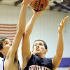 Globe/T. Rob Brown<br /> Southwest's Josh Cutberth shoots for two as Thomas Jefferson's Justin Brown plays defense Monday night, Jan. 9, 2012, at Thomas Jefferson's gymansium.