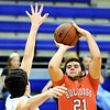 Globe/T. Rob Brown<br /> Carl Junction's Chase Marrs attempts a field goal over Carthage's Nathan Reid Monday evening, Jan. 16, 2012, at Carthage High School's gymnasium.
