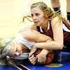 Globe/T. Rob Brown<br /> Carthage's Chloé Shepherd and Joplin's Casee Wheeler fight for a loose ball Monday evening, Jan. 16, 2012, at Carthage High School's gymnasium.