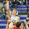 Globe/T. Rob Brown<br /> Carthage's Kyle Reed shoots for two as he climbs up Carl Junction's Travis Vogt Monday evening, Jan. 16, 2012, at Carthage High School's gymnasium.