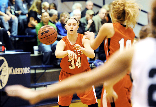 Globe/T. Rob Brown<br /> Miller's Emily Allen (34) passes the ball to teammate Emily Ellison (10) against College Heights Christian School Monday evening, Jan. 30, 2012, during McAuley Catholic High School's Warrior/Lady Warrior Classic in McAuley's gymnasium.