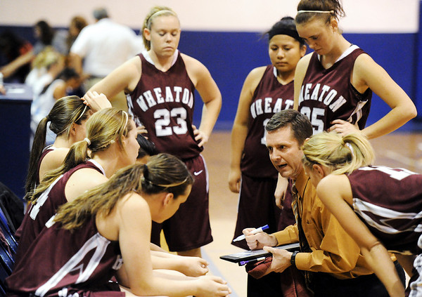 Globe/T. Rob Brown<br /> Wheaton's coach gives the team direction during a timeout in Monday evening's game, Jan. 23, 2012, against McAuley Catholic High School at McAuley's gymnasium.