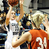 Globe/T. Rob Brown<br /> College Heights Christian School's Brianna Shores passes the ball over Miller's Emily Allen Monday evening, Jan. 30, 2012, during McAuley Catholic High School's Warrior/Lady Warrior Classic in McAuley's gymnasium.