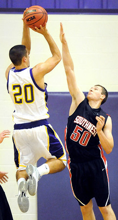 Globe/T. Rob Brown<br /> Southwest's Skylar Knoll puts defensive pressure on Thomas Jefferson's Alex Oserowsky as he attempts a shot Monday night, Jan. 9, 2012, at Thomas Jefferson's gymansium.