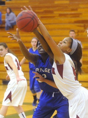 Globe/Roger Nomer<br /> Joplin's Bailey Taylor knocks a pass away from Carthage's Sierra Barrett during Monday's game.