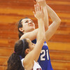 Globe/Roger Nomer<br /> Carthage's Vanessa Pawlak goes up for a shot over Joplin's Samantha Stout during Monday's game.