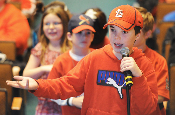 Globe/T. Rob Brown<br /> Caleb Long, 13, of Webb City, asks the Cardinals Caravan members about the team's past post-season performance against the San Francisco Giants Saturday afternoon, Jan. 19, 2013, at MSSU's Taylor Performing Arts Center.