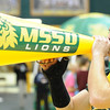 Globe/T. Rob Brown<br /> MSSU Spirit Squad member Levi Stone, junior health promotion major, cheers on the Lions Thursday evening, Jan. 3, 2013, at MSSU's Leggett & Platt Athletic Center.