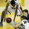 Globe/T. Rob Brown<br /> Joplin's Keiondre Adams picks up a loose ball after teammate Adam St. Peter and a Camdenton player grappled for it during Friday night's game, Jan. 11, 2013, at MSSU's Young Gymnasium.